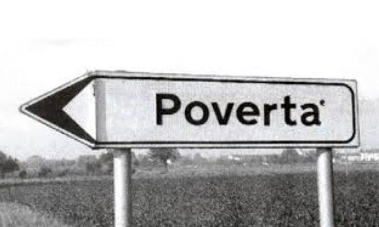 """Cartello stradale con scritto """"povertà"""""""
